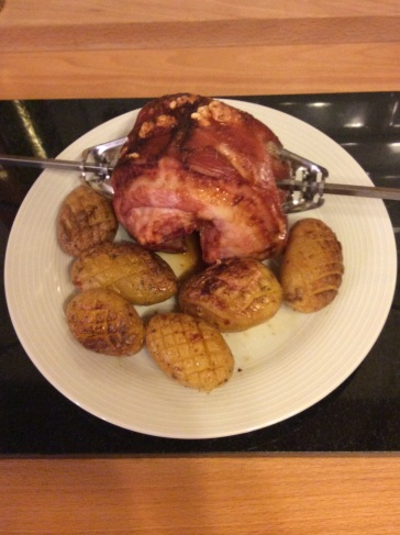Pork Belly Rotisserie with hassleback potatoes from the Kernolou Kitchen