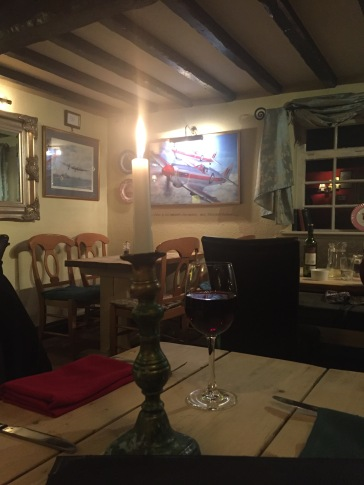 Pictures of aircraft on the walls of the John Barleycorn pub at Duxford